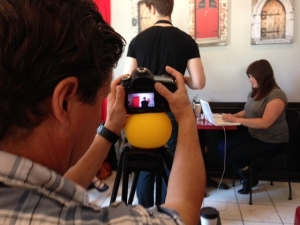 Director of Photography Michael Jari Davidson sets up one of the final shots.  Chris Whidden (Ethan the barista) attends table with laptop lady Devon Hubka (wearing pants!).  Photo:  Shannon McDonough