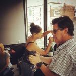 """Makeup artist Davida Gragor and cinematographer Michael Jari Davidson at work on set of """"Aloud""""."""