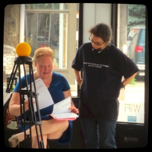 Director/producer PJ Hammond and screenwriter/producer Tina McCulloch confer about script and shot list on Day 1 (July 14, 2015) of Aloud shoot. That yellow ball on the tripod? Belongs to cinematographer Michael Jari Davidson. Photo: Jo-Anne Wurster.